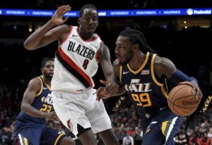 Utah Jazz forward Jae Crowder, right, drives to the basket on Portland Trail Blazers forward Al-Faro