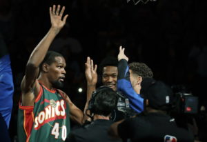 Golden State Warriors forward Kevin Durant, left, appears during player introductions wearing the je