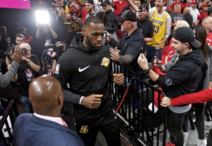 Los Angeles Lakers forward LeBron James heads to the court before an NBA basketball game against the