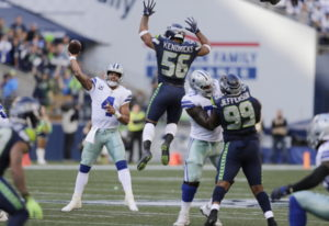 FILE - In this Sept. 23, 2018, file photo, Seattle Seahawks linebacker Mychal Kendricks (56) leaps a