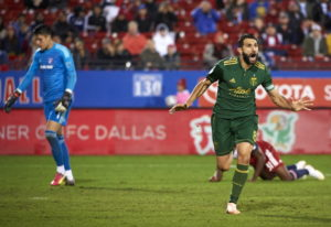 Portland Timbers midfielder Diego Valeri (8) celebrates after scoring a goal against FC Dallas durin