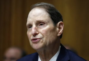 Sen. Ron Wyden, D-Ore., ranking member of the Senate Finance Committee, speaks during a hearing on t