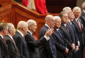 The Church of Jesus Christ of Latter-day Saints President Russell M. Nelson, center, greets the twic