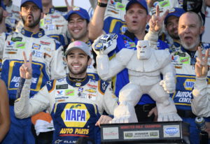 Chase Elliott, front left, poses with the trophy in Victory Lane after he won a NASCAR Cup Series au