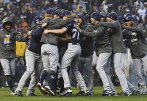 Milwaukee Brewers celebrate after the final out by the Colorado Rockies in the ninth inning of Game