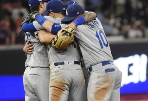 Los Angeles Dodgers team members embrace after Game 4 of baseball's National League Division Series