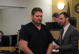 Nicholas A. Clark (center) appears in Clark County Superior Court on Monday to face charges of posse