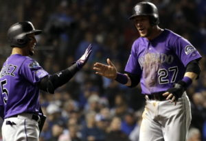 Colorado Rockies' Trevor Story, right, celebrates with Carlos Gonzalez after scoring the go-ahead ru