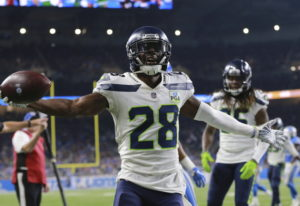 Seattle Seahawks cornerback Justin Coleman (28) reacts after interception a pass at the goal line in