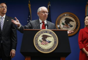Attorney General Jeff Sessions, joined by Deputy Attorney General Rod Rosenstein, left, and Jessie L