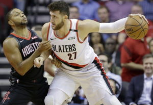 Portland Trail Blazers center Jusuf Nurkic (27) dribbles as Houston Rockets guard Eric Gordon defend