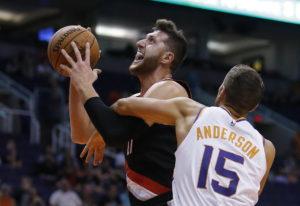Portland Trail Blazers center Jusuf Nurkic is fouled by Phoenix Suns forward Ryan Anderson (15) duri