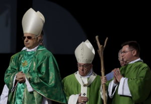 Pope Francis, center, arrives to celebrate a Mass for the opening of a synod, a meeting of bishops,