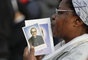 A woman holds a picture of martyred Salvadoran Archbishop Oscar Romero in St. Peter's Square at the