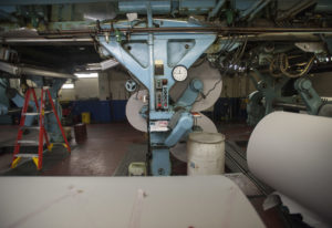 Newsprint arrives on big rolls, which are attached to the underside of The Columbian''s Goss Me