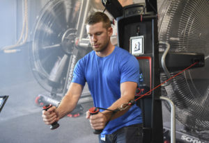Gabriel Baker, a retail project manager at The Nautilus Shop in Vancouver, demos the Bowflex Hybrid