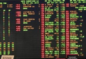 Sports betting lights up casinos in Las Vegas. (Lou Brancaccio)
