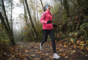 Jane Connell jogs near Lacamas Lake in Camas. Connell will participate in a fundraiser challenge to