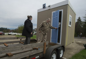 Jeannie Hix and her husband, entrepreneur Steve Hix, prepare to enter one of the Dwellings of Hope i
