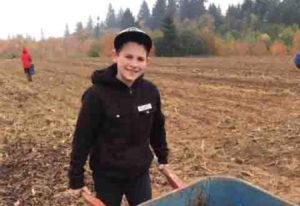 Northeast Hazel Dell: Image Elementary School fifth-grader Mason Phernetton pushes a wheelbarrow at