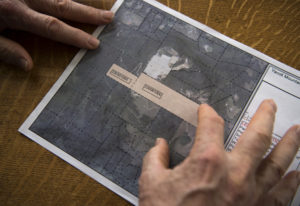 Gary Ogier looks at a map of proposed overlay near the Yacolt Mountain Quarry that has him and other