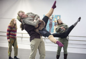 "Devan Cochelle, center, gets a lift while rehearsing ""Hounds of Winter,"" a scene about poverty in Da"