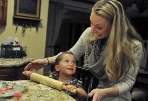 Aliyah and Gwen Bumala prepare for Thanksgiving by baking sugar cookies and treats Tuesday at their