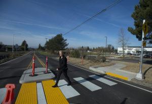 Heidi Rosenberg, director of capital programs for the Camas School District, uses a new crosswalk to