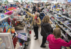 Shoppers pack an aisle of the new Vancouver Goodwill at 14201 N.E. Fourth Plain Blvd. during the gra