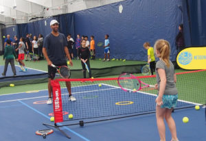James Blake hit tennis balls with kids during a community event at the Vancouver Tennis Center on Sa