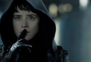 "Lisbeth Salander (Claire Foy) makes her way to Balder's safe house in Columbia Pictures' ""The Girl i"