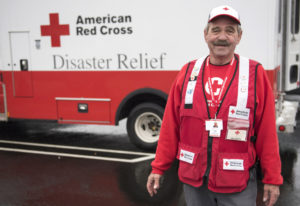 Ron Burby Red Cross volunteer Ron Burby of Vancouver stands for a photo in front of a Red Cross vehi