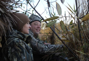 Jennifer and Douglas Hawkins search the sky for ducks as they take part in the first Ridgefield Nati