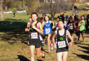 Abigail Rounds, left, and Addison Crum compete in the 11-12 age group race at the USATF Junior Olymp