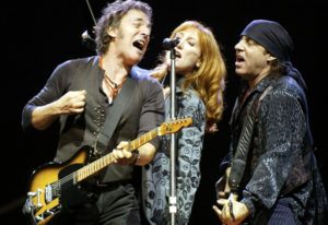 Bruce Springsteen, left, performs with his wife, Patti Scialfa, and Steve Van Zandt in Gelsenkirchen