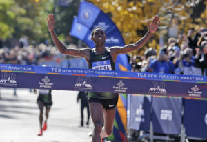 Lelisa Desisa, of Ethiopia, crosses the finish line first in the men's division of the New York