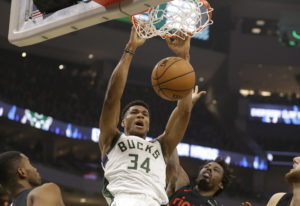 Milwaukee Bucks' Giannis Antetokounmpo dunks against the Portland Trail Blazers during the firs