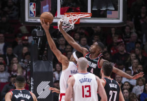 Portland Trail Blazers' Maurice Harkless (4) tries to defend as Los Angeles Clippers's Tob
