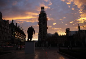 The sun rises as seen in Parliament Square with the statue of former Prime Minister Winston Churchil