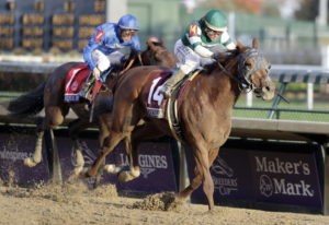 Joel Rosario (14) rides Accelerate to victory as Christophe Soumillon follows on Thunder Snow in the