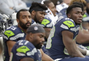 Seattle Seahawks players, including wide receivers David Moore, right, and Doug Baldwin, upper left,