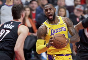 Los Angeles Lakers forward LeBron James, right, drives to the basket towards Portland Trail Blazers