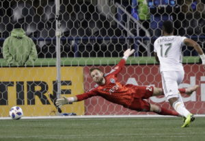 Seattle Sounders goalkeeper Stefan Frei, left can't get to the ball on a goal by Portland Timbers mi