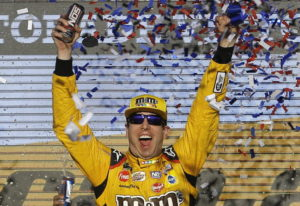 Kyle Busch (18) celebrates after winning a NASCAR Cup Series auto race on Sunday, Nov. 11, 2018, in