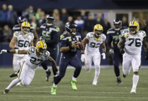 Seattle Seahawks quarterback Russell Wilson (3) scrambles away from Green Bay Packers defensive back