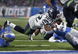 Seahawks running back Chris Carson (32) could miss Sunday's game against the Rams with a hip injury.