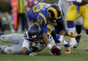 Los Angeles Rams defensive end Dante Fowler forces a fumble against the Seattle Seahawks during the