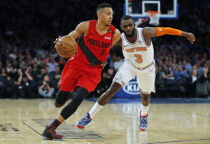 Portland Trail Blazers guard CJ McCollum (3) drives to the basket past New York Knicks guard Tim Har