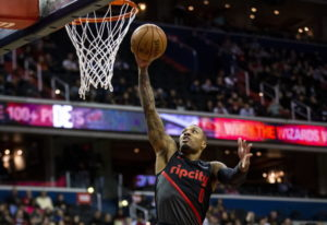 Portland Trail Blazers guard Damian Lillard (0) makes a layup past Washington Wizards forward Otto P