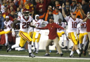 Southern California' Aca'Cedric Ware (28) races past his bench on a 57-yard touchdown run in the fir